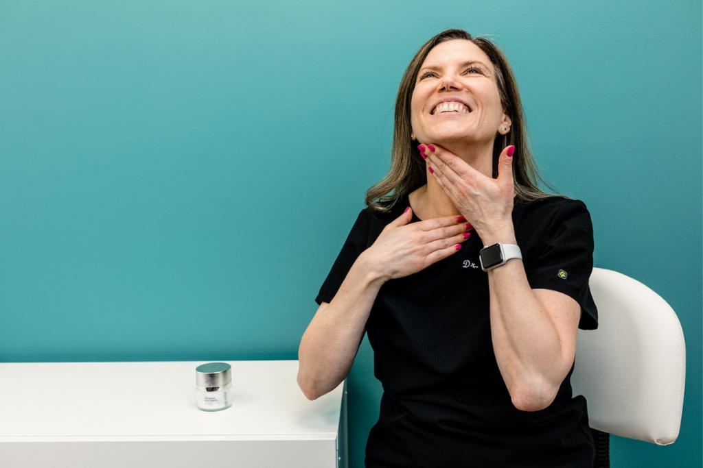 applying skincare product neck